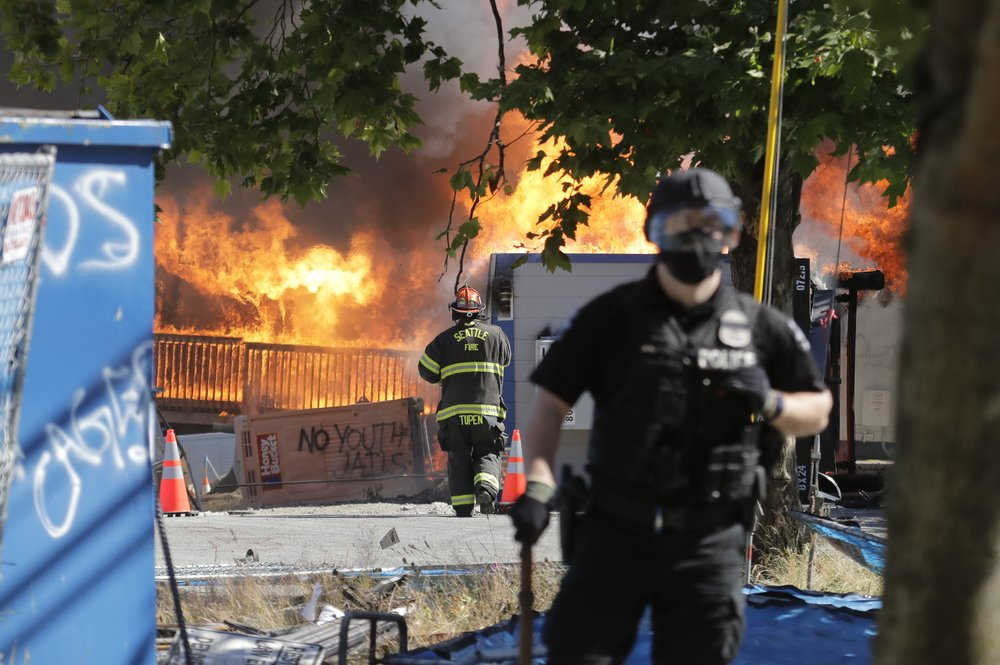 Authorities declare riots in Portland, Seattle as weeks of unrest ...